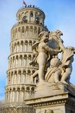 Leaning Tower of Pisa. A view of the Leaning Tower of Pisa with a decorative statue in the foreground Royalty Free Stock Photos