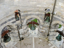 The Leaning Tower of Pisa. Detail of the bronze bells inside the marble Leaning Tower of Pisa Stock Photography
