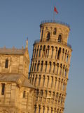 Leaning tower of Pisa & Duomo. A picture of the Leaning Tower of Pisa and the Duomo (cathedral) in evening lighting stock photos