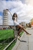 The Leaning Tower of Pisa, Italy. A beautiful woman taking a photo with the famous landmark Tower of Pisa in Italy Royalty Free Stock Photo