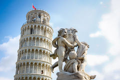 The leaning tower of Pisa, Italy. Photo of the leaning tower of Pisa, Italy with a statue group of angels Stock Photos
