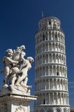 Leaning Tower Of Pisa (Italy). Statue And Leaning Tower Of Pisa (Italy). Blue sky in the background Royalty Free Stock Photography