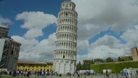 Leaning tower of Pisa in Italy, tourists enjoying view of popular landmark, tour. Stock footage stock video