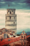 The Leaning Tower in Pisa, Italy. Unique rooftop view. Vintage. The Leaning Tower in Pisa, Italy. Unique perspestive from rooftop, dark clouds. Vintage Tuscany Royalty Free Stock Photo