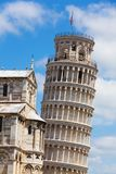 Leaning tower in Pisa and part of Cathedral Stock Photo