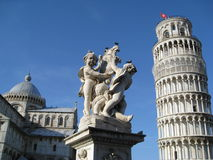 Leaning Tower of Pisa, Pisa Cathedral and Cherubs. Architecture in Pisa Italy, including the leaning tower and cherub statue Stock Photos