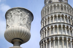 The Leaning Tower of Pisa with a statue Royalty Free Stock Photo