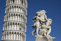 The Leaning Tower of Pisa with a statue in foreground Stock Image