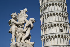 The Leaning Tower of Pisa with a statue in foreground Royalty Free Stock Image
