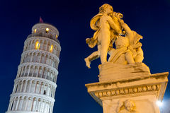 Leaning Tower of Pisa with statue after sunset Stock Photography