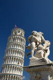 Leaning tower of Pisa with statue. A statue on the top of a funtain with the leaning tower of Pisa in background Royalty Free Stock Photos