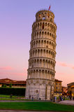 The Leaning Tower of Pisa (Torre pendente di Pisa) at sunset in Pisa, Italy. The Leaning Tower of Pisa is one of the main landmark of Italy Stock Photos