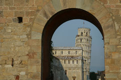 Leaning tower of Pisa under an arch Stock Image