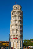Leaning Tower of Pisa. Visitors gather at the base of the famous Leaning Tower of Pisa in Italy Stock Image
