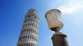 The Leaning Tower of Pisa, a wonderful medieval monument, one of the most famous landmark in Italy, with roman vase Stock Images