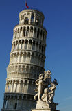Leaning tower with statue royalty free stock photo