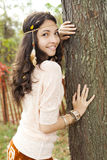 Leaning on a tree Royalty Free Stock Photo