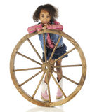 Leaning on the Wheel Royalty Free Stock Images