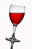 Leaning wine glass with red wine Royalty Free Stock Photo