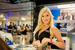 Leanna Bartlett. Is a professional model with lots of experience. Here you can see her signing prints for her fans Royalty Free Stock Image