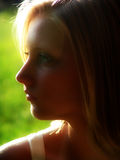 Leanne #2. Side view/profile of girl, backlit Stock Photo