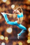 Leap. Young girl making acrobatic leap Royalty Free Stock Image