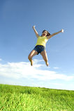 Leap. Happy mom jumps in the air as she gets a day off from her kids