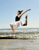 Leap on beach. Happy woman leaps in beach Stock Image