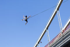 Leap from the bridge with the rope. Extreme sport, jumping, adrenaline. The man jumped from the bridge with the rope Royalty Free Stock Photography