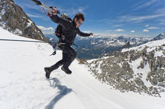 Leap of faith. Mountaineer on a Italian glacier (Mont Blanc Massif, Italian Alps Royalty Free Stock Photo