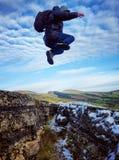 Leap of faith across a gap stock photos