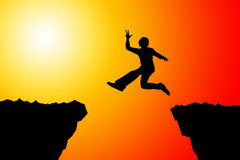 Leap of faith. Taking chances and risks, and making a leap of faith Stock Images