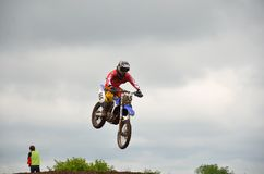 A leap over the hill motocross racer Stock Photo