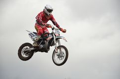 A leap over the hill, motorcycle racer Stock Image