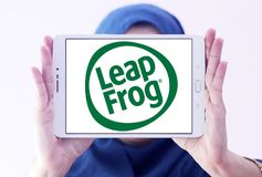 LeapFrog Enterprises logo. Logo of LeapFrog Enterprises on samsung tablet holded by arab muslim woman. LeapFrog is an educational entertainment and electronics royalty free stock image