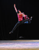 Leaping into the air-The national dance training Stock Image