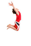 Leaping child hands stretched to sky Royalty Free Stock Photos