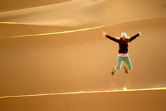 Leaping on the dune Stock Photography
