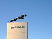 Leaping Jaguar Emblem. And text on a plinth outside a Jaguar car dealership showroom. Shrewsbury, England Royalty Free Stock Photography