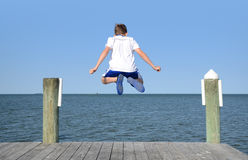 Leaping Off Dock Royalty Free Stock Photos