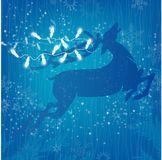 Reindeer White Christmas Lights on Blue Background with Stars. Leaping Reindeer trailing White Christmas Lights on Blue Background with Stars and snowflakes Stock Image