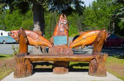 A beautifully carved bench outside the tourism building at soldotna royalty free stock photography