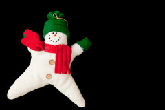 Leaping Snowman. Christmas decoration on a black background Stock Photography