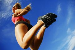 Leaping Woman. Beautiful woman leaping into air against sky, low angle Stock Images