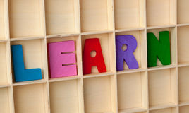 Learn. Wooden letter blocks forming the word LEARN Royalty Free Stock Photography