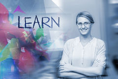 Learn against confident female teacher in computer class Royalty Free Stock Photography