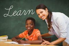 Learn against green chalkboard Royalty Free Stock Photo