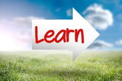 Learn against sunny landscape. The word learn and arrow against sunny landscape Royalty Free Stock Images