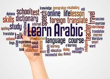 Learn Arabic word cloud and hand with marker concept. On white background stock photography