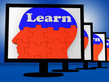 Learn On Brain On Monitors Showing Human Studying Royalty Free Stock Image